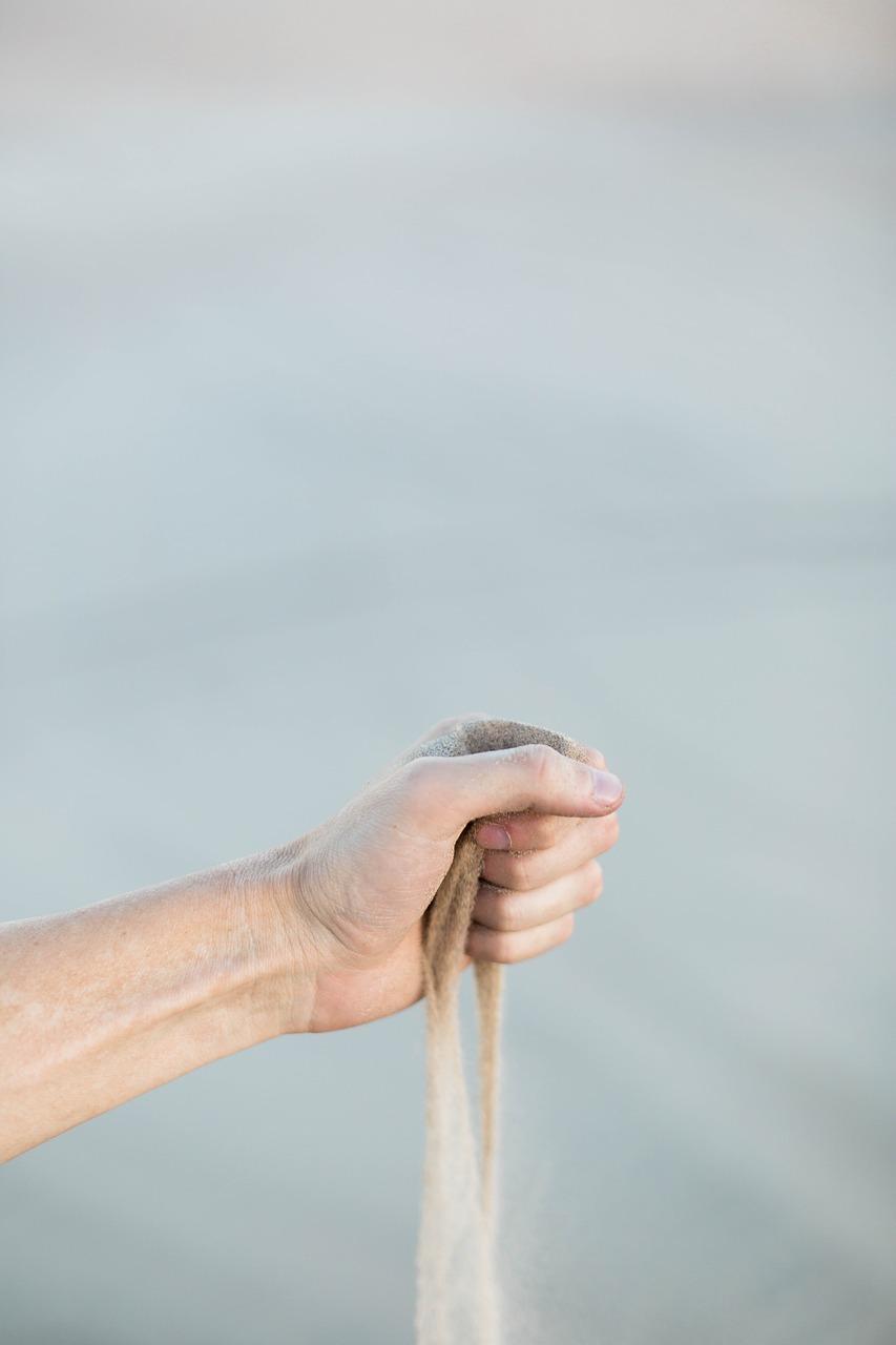 zand in hand loslaten